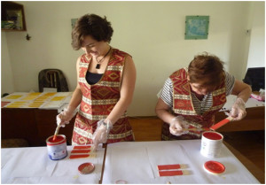 AWHHE expert and volunteer preparing samples of the purchased paints for analysis by IPEN